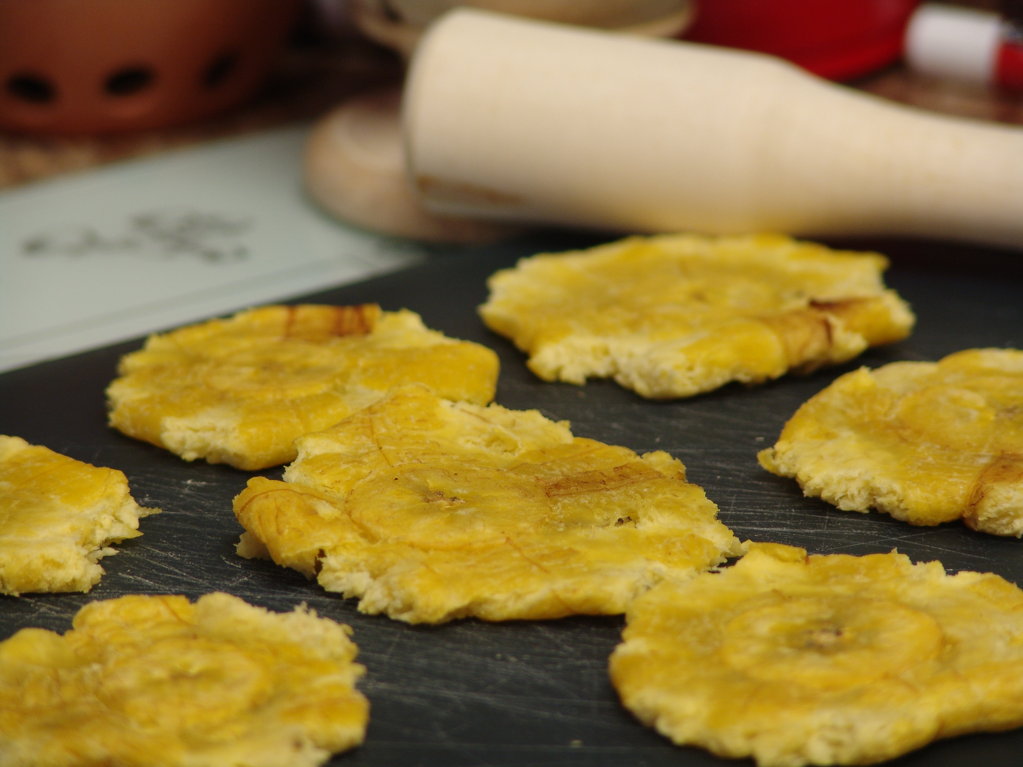 Pressed tostones waiting to be fried for the second time.