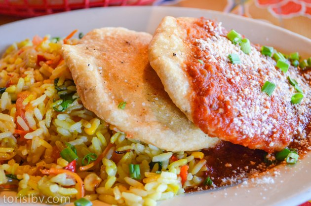 PUPUSA - Two Salvadorian masa cakes, filled with cohja cheese black beans, chicken or beef.