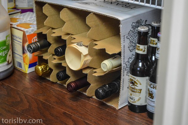 Makeshift wine cellar in the bottom of the cupboard