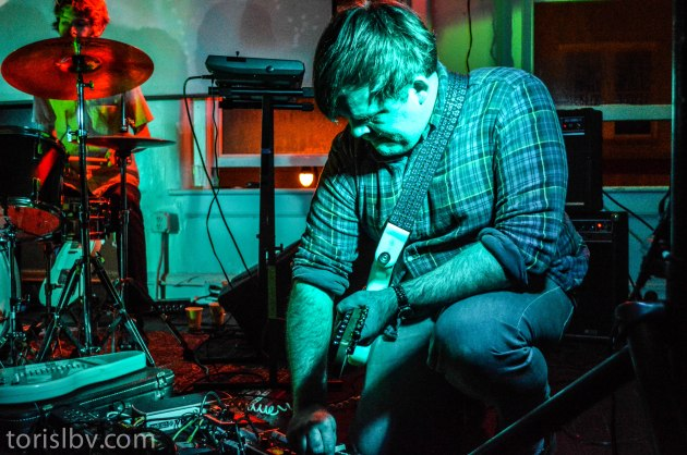 Lilac Shadows Guitar player Nathan Price using his controls to bend sound.