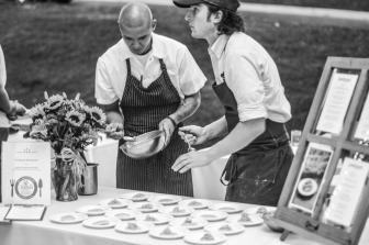 Chef Ben Adams and crew from Piedmont Restaurant plating their dish.